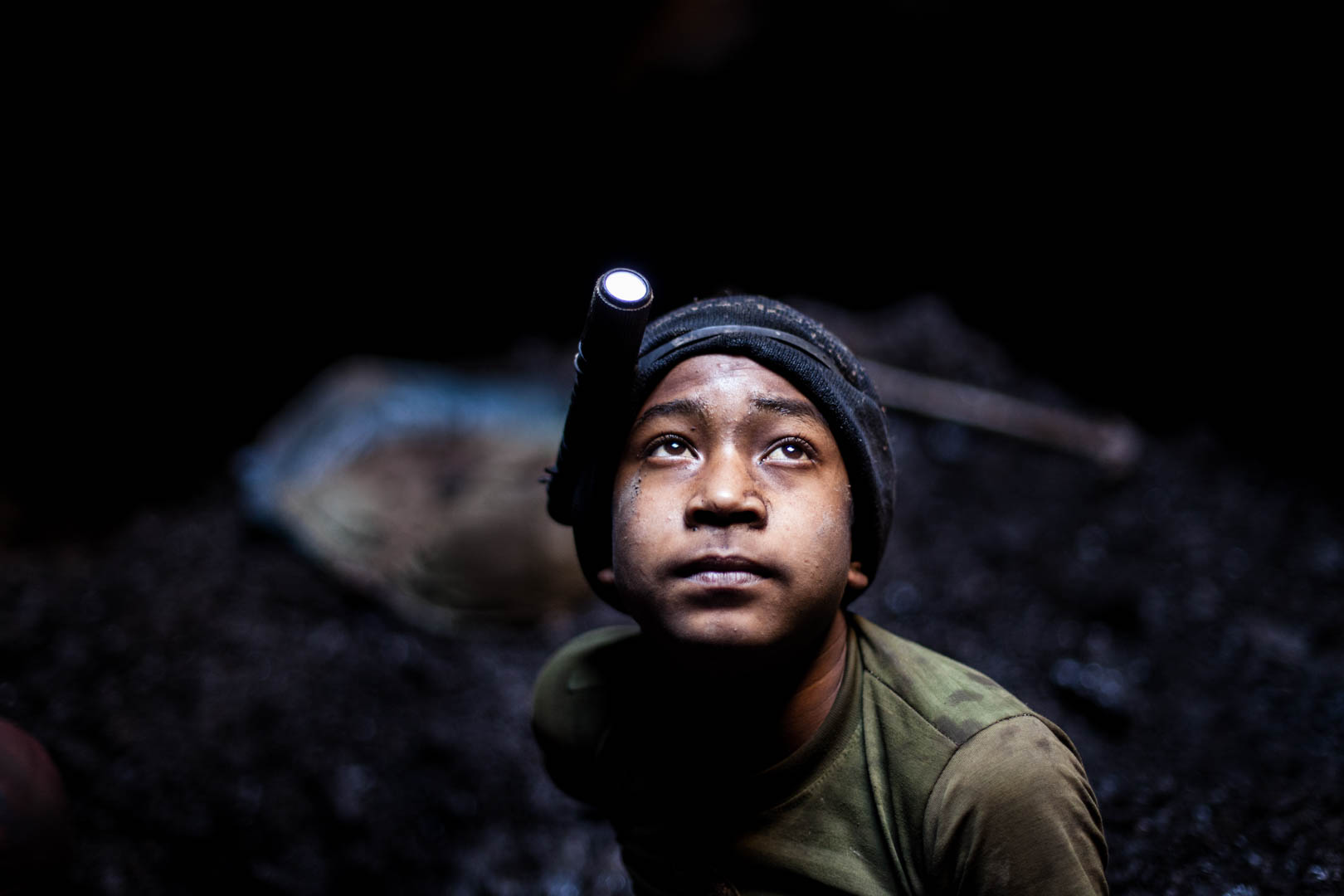 Ashok, an eight year old boy from India, works in the mines since he is five years old. He starts to dig for coal at five in the morning and finishes by 3PM. He says he prefers making money over going to school.