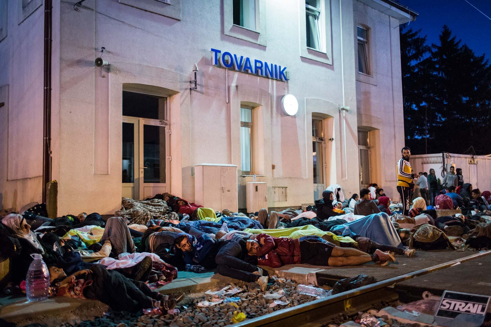 Refugees unable to find a spot on the train to Slovenia, sleep at the railway station of the small border village Tovarnik.