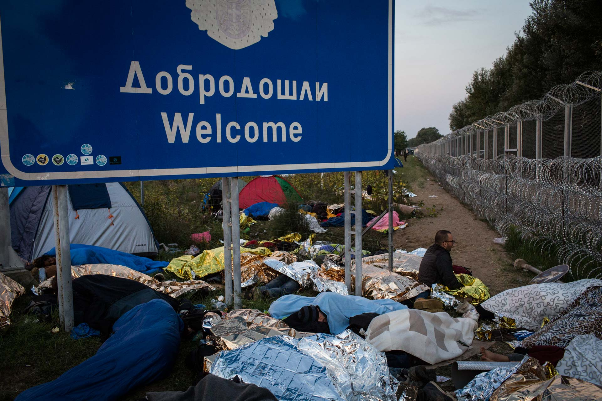With the border between Serbia and Hungary closed, many people set up camp on a now closed highway directly on the fence separating the two countries.
