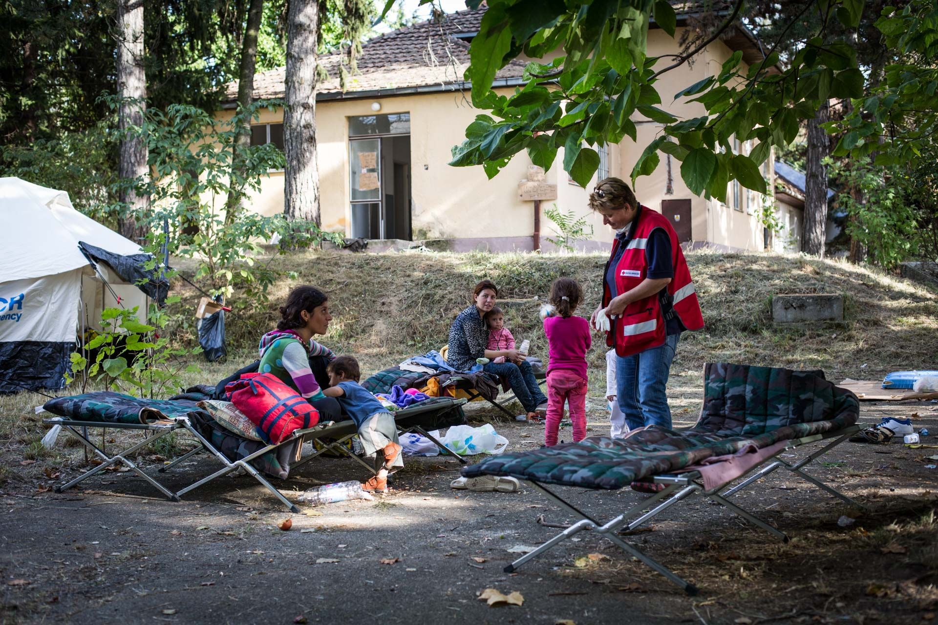 The Croatian red cross set up a camp in a nearby former army base to accomodate hundreds of people waiting to continue their journey to Europe.