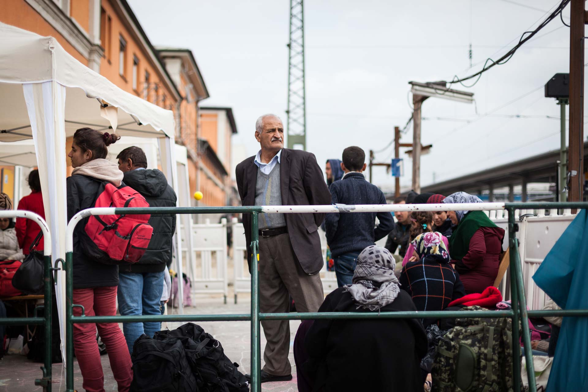A Yezidi man from Sinjar in Iraq is waiting for an ambulance for his wife at the train station in Passau, Germany. She twisted her ankle somewhere in Serbia.