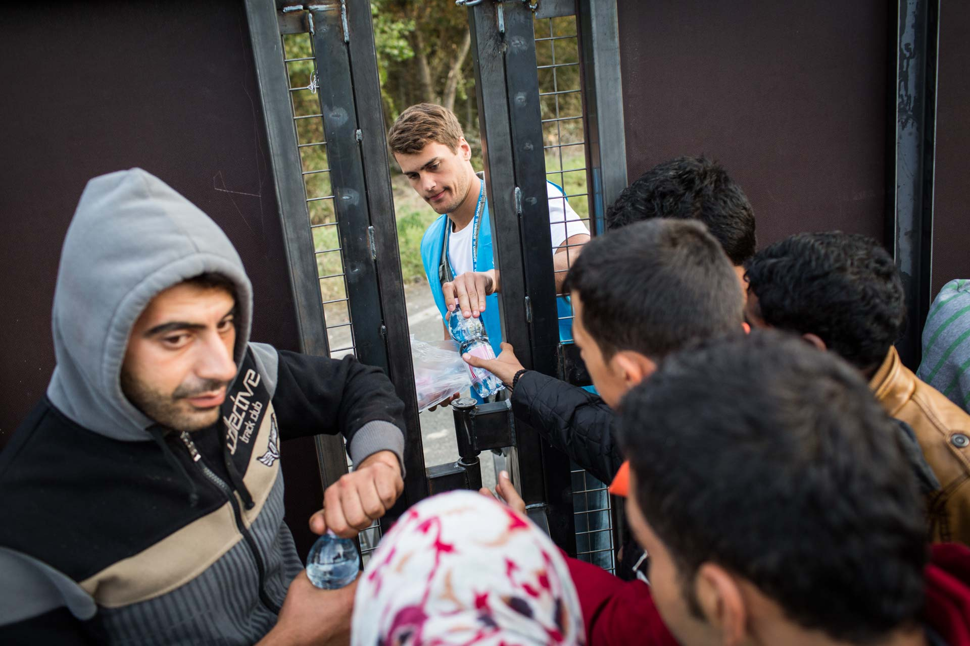 Volunteers distribute water from the Hungarian side of the fence because Serbian officials are not distributing any help on their side of the border.