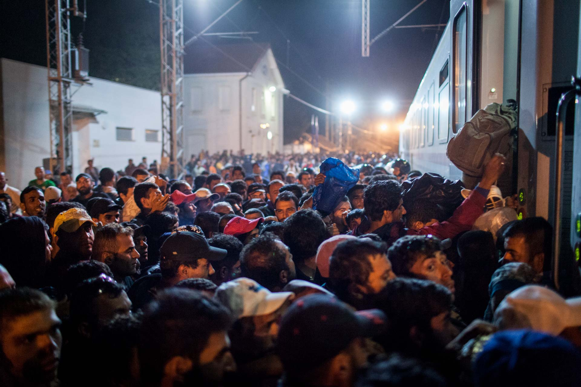 With the way to Hungary closed, many refugees diverted to Croatia instead, in order to get to Western Europe. After waiting for days for a transport to transfer them to Slovenia, thousands of people fight for a spot on a train.
