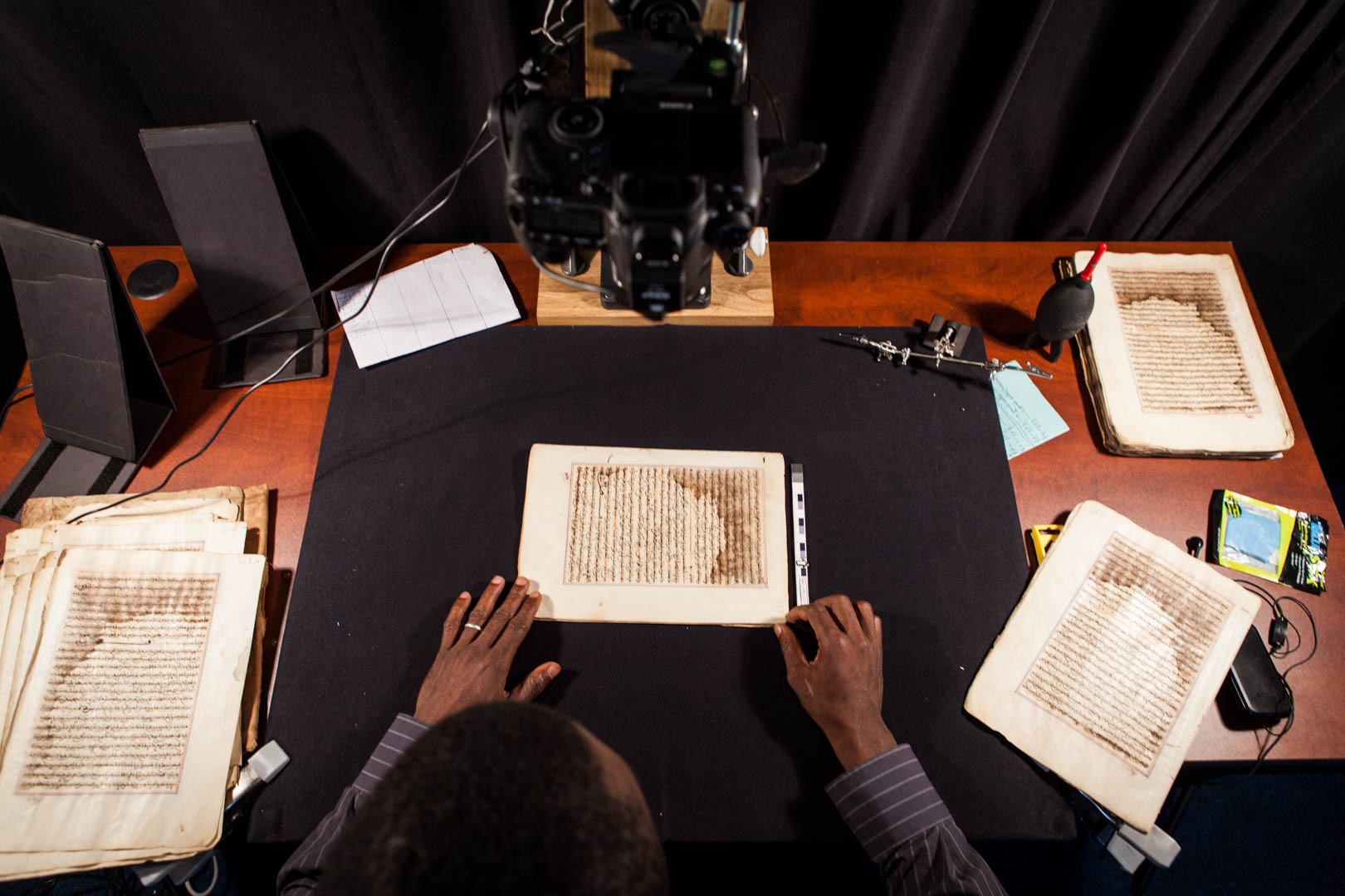 A manuscript from a library in Timbuktu gets photographed and archived.