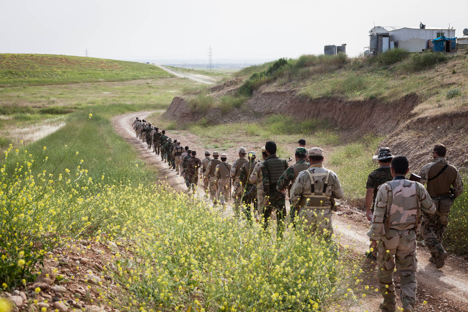 After their training at the firing range, a battalion of the Peshmerga is walking back to their compound. They receive training five days a week, for four weeks.