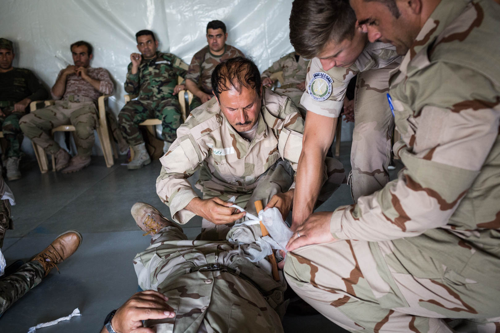Kurdish Peshmerga forces receive combat emergency training by German army forces to prevent unnecessary deaths due to minor and major combat injuries. They have never been trained how to treat injuries when they joined the Peshmerga.