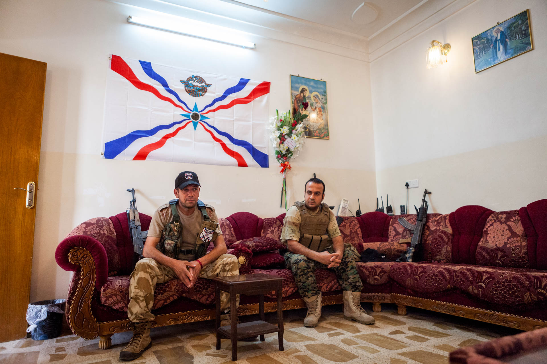 Two members of the Dwekh Nawsha in their headquarters in Bakufa. From here, Mosul is roughly 35 km away.
