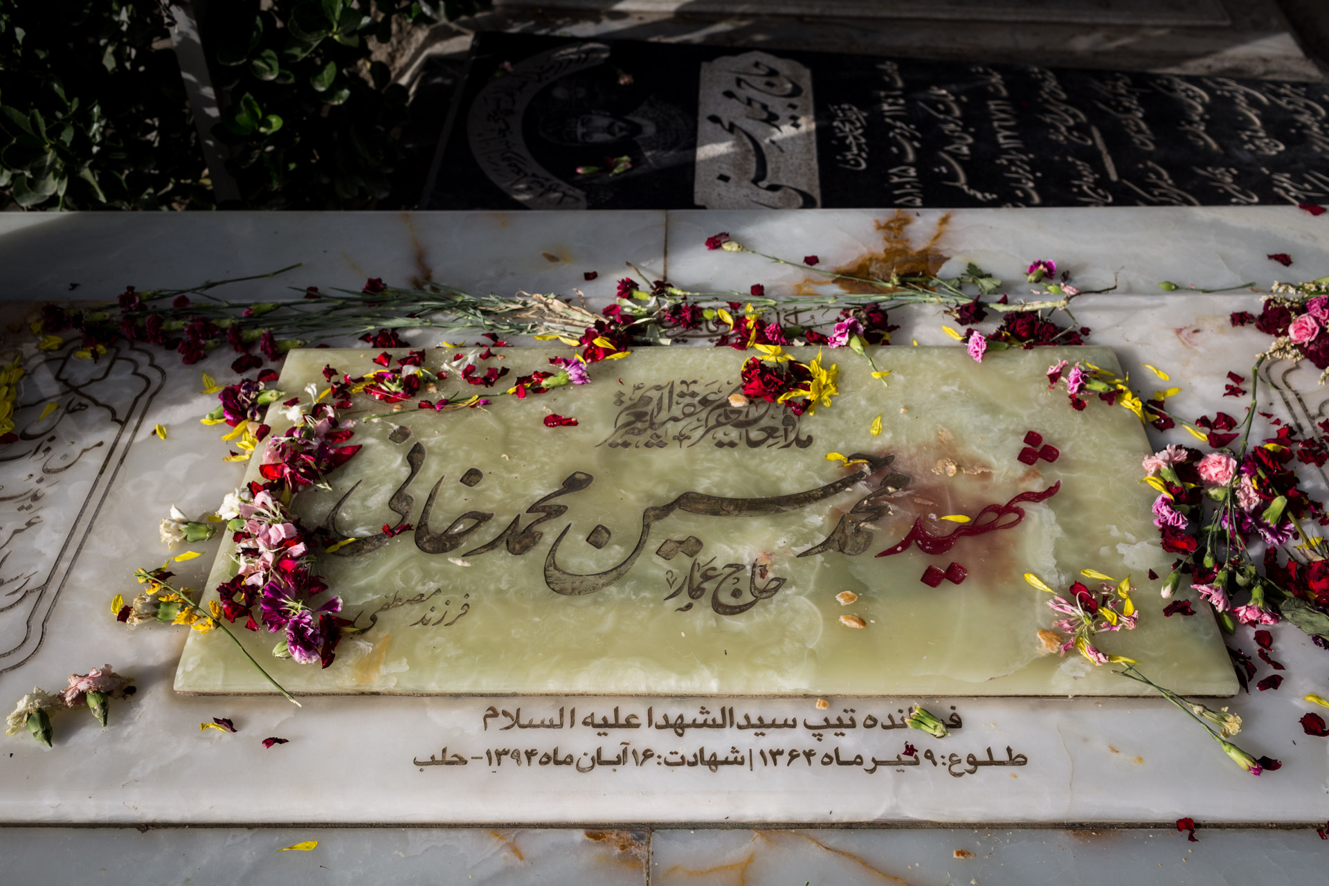 "The plate of a martyr's grave reads ""Aleppo"" (""halab"") as place of his martyrdom."