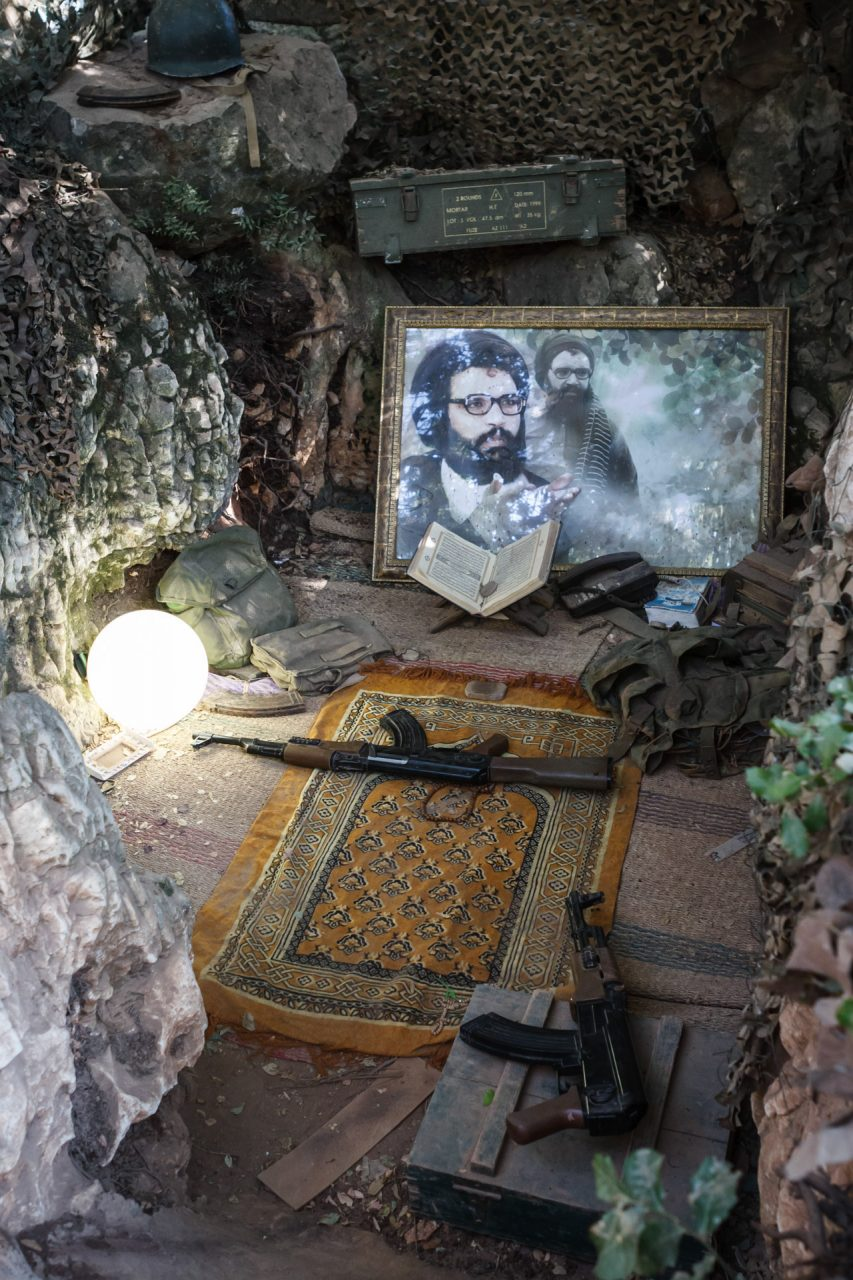 A trench that served as a place for worship is equipped with two Kalashnikov rifles and a portrait of former secretary general Abbas al Moussawi, who was assassinated by Israeli Defense Forces in 1982.